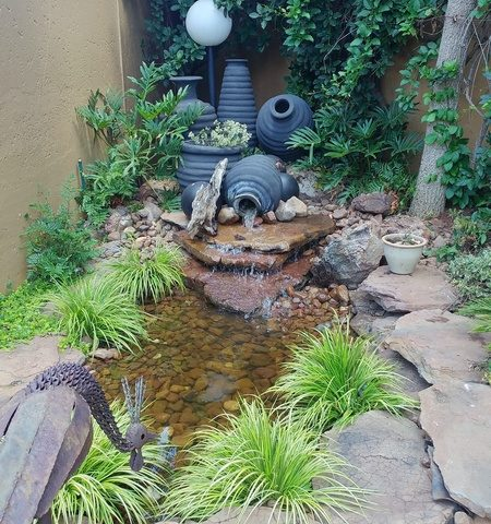 Water Feature with Pond and Pots